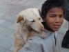 Street kid with his dog